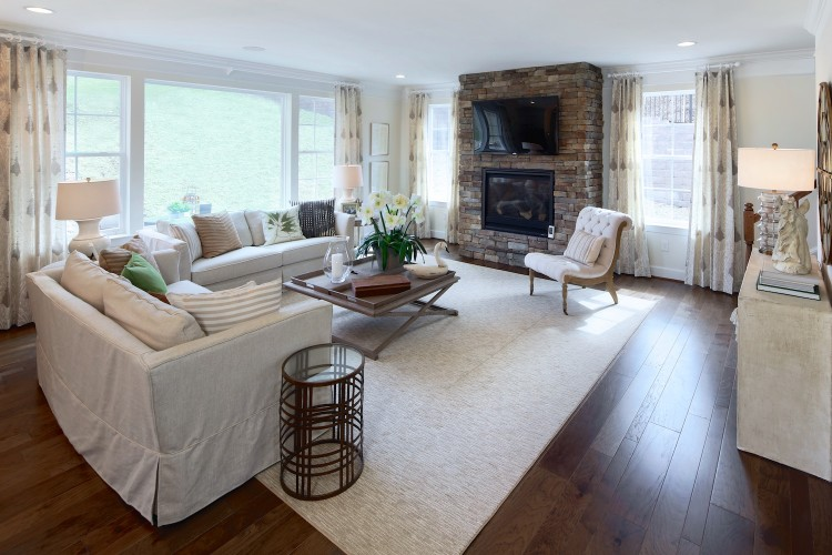 Family room with large stone fireplace and large windows