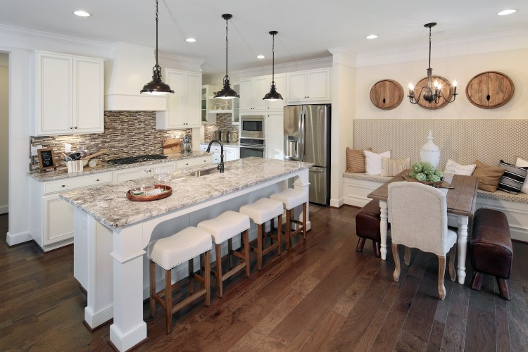 Open kitchen with large island and table with built in seating