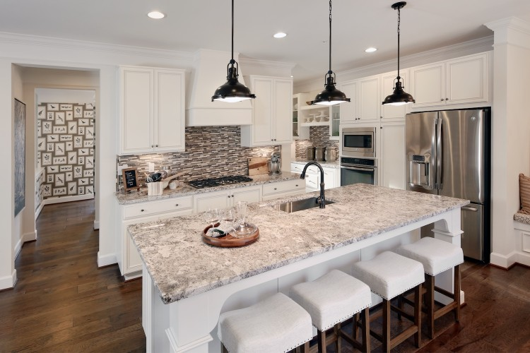 Open kitchen with large island and light cabinets