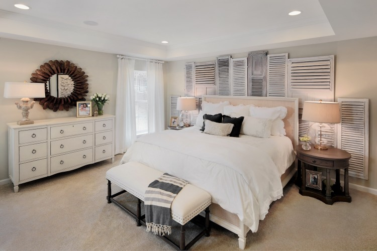 Bedroom with white comforter and white dresser