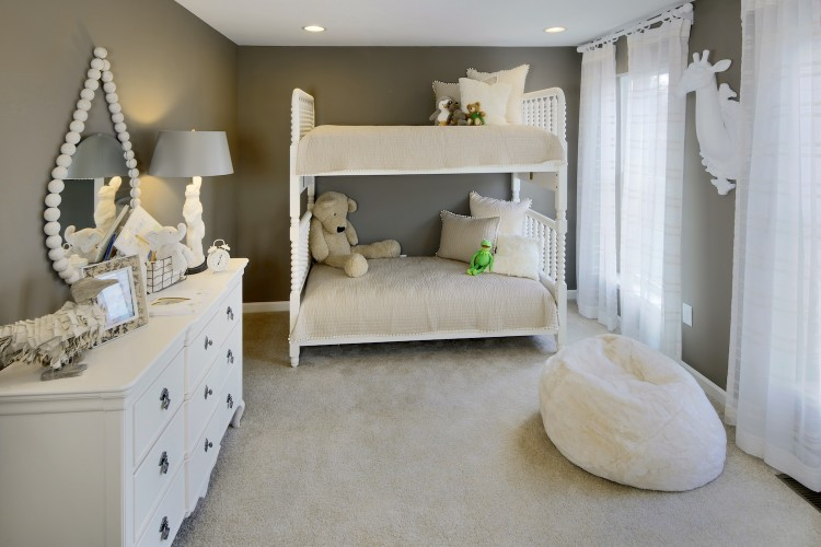 Bedroom with white bunk beds and grey walls