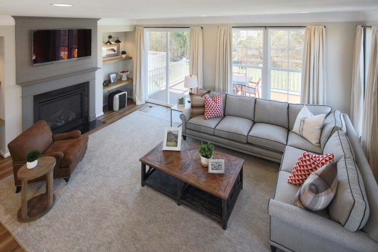 Great room view with fireplace and large grey sectional
