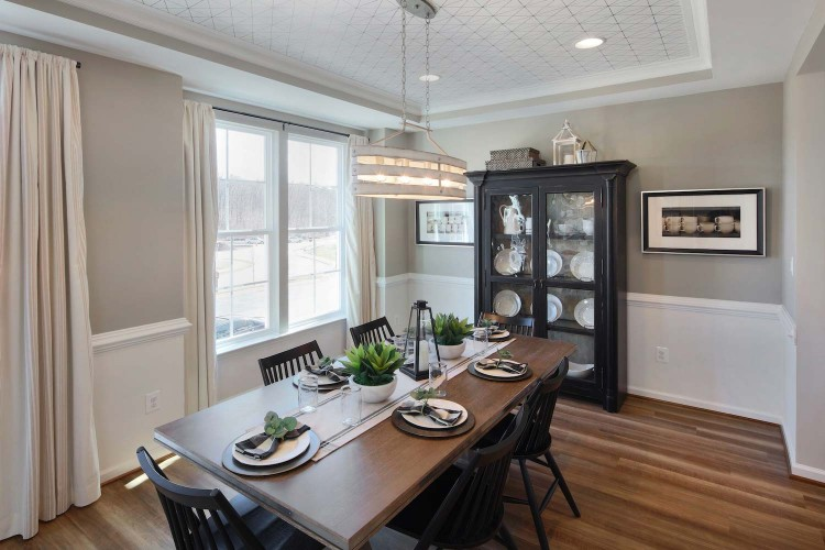 Dining room with 6 seater table and large windows