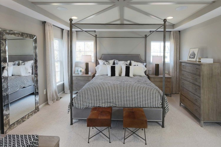 Bedroom with tray ceiling and 4 poster bed