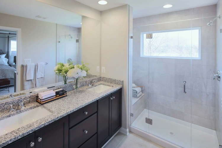 Bathroom with shower with a seat