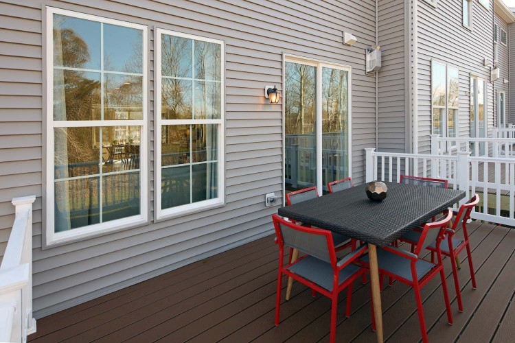 Deck with table with red chairs