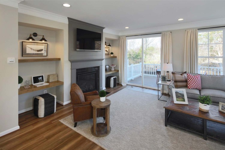 Great room view from kitchen with fireplace and large grey sectional