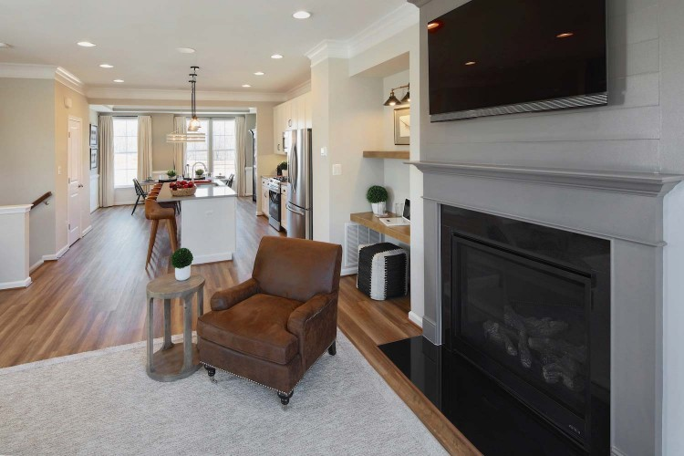 Great room with fireplace and view into kitchen