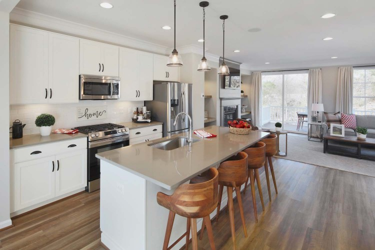 Great room showing eat in kitchen with wood stools