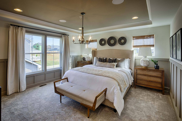 bedroom at the Atwood Model home at Tapestry